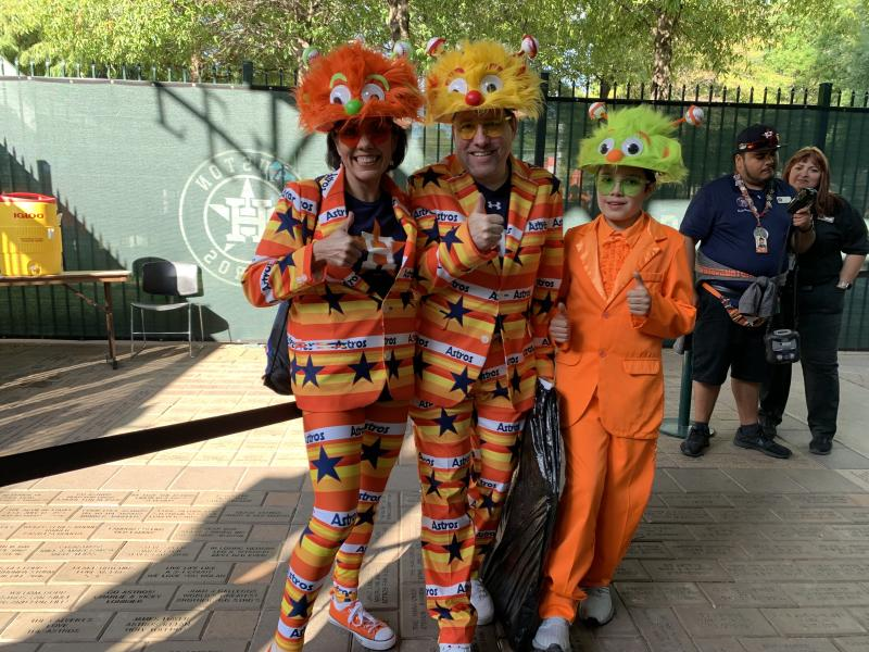 A family of Astros fans with their suits and custom-made hats. (Photo by Hannah Keyser.)