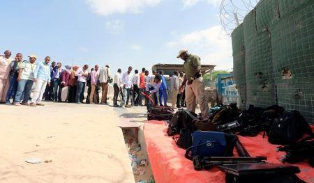 Journalists queue for a security sweep outside the venue of the presidential vote at the airport in Somalia's capital Mogadishu February 8, 2017. REUTERS/Feisal Omar