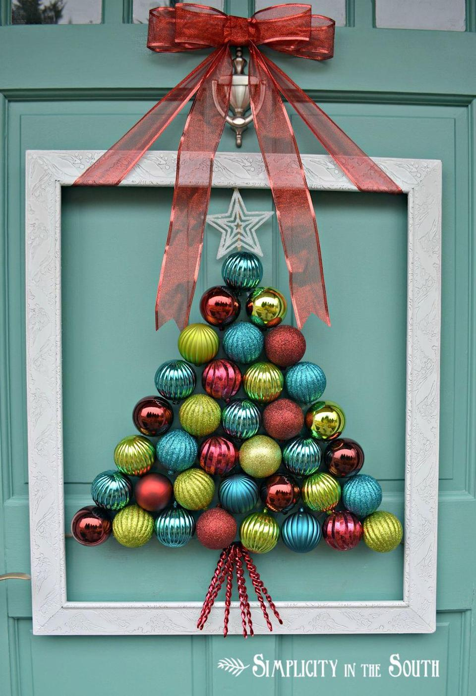 "<p>Frame a colorful Christmas tree and tie it with a big red bow for a true statement maker. <br></p><p><em><a href=""http://www.simplicityinthesouth.com/2012/12/framed-christmas-tree-ornament-wreath.html"" rel=""nofollow noopener"" target=""_blank"" data-ylk=""slk:Get the tutorial at Simplicity In the South »"" class=""link rapid-noclick-resp"">Get the tutorial at Simplicity In the South »</a></em><br></p>"