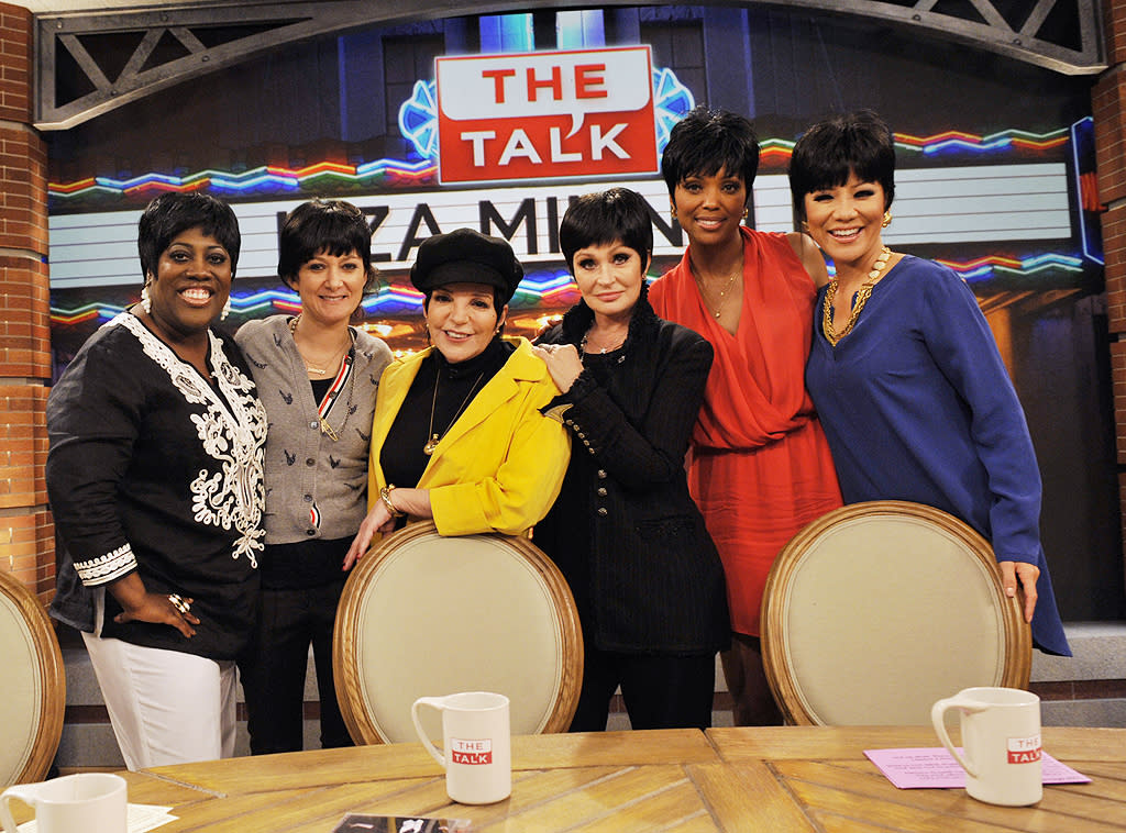 "No, you're not seeing sextuplets. It's just the ladies of ""The Talk"" paying tribute to legendary performer Liza Minnelli (in yellow). Co-hosts (L-R) Sheryl Underwood, Sara Gilbert, Sharon Osbourne, Aisha Tyler, and Julie Chen donned wigs emulating the 66-year-old's iconic hairstyle when Liza stopped by the show on Tuesday. But can they sing ""Cabaret""? (5/15/2012)"