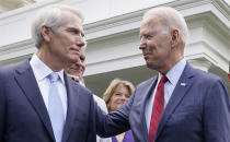 FILE—In this file photo from June 24, 2021, President Joe Biden speaks with Sen. Rob Portman, R-Ohio, left, and other bipartisan group of senators outside the White House in Washington after Biden invited members of the group of 21 Republican and Democratic senators to discuss an infrastructure plan. Portman, a three-decade Washington veteran plans to retire rather than run next year. He announced in January he would not seek a third term, saying it had become too hard to get things done. (AP Photo/Jacquelyn Martin, File)