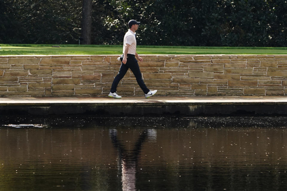 Rory McIlroy, of Northern Ireland, walks along the 15th fairway during the final round of the Masters golf tournament Sunday, Nov. 15, 2020, in Augusta, Ga. (AP Photo/Matt Slocum)