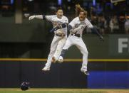 Milwaukee Brewers' Ben Gamel celebrates with Keston Hiura after hitting a walk-off single during the ninth inning of a baseball game against the San Francisco Giants Saturday, July 13, 2019, in Milwaukee. The Brewers won 5-4. (AP Photo/Morry Gash)