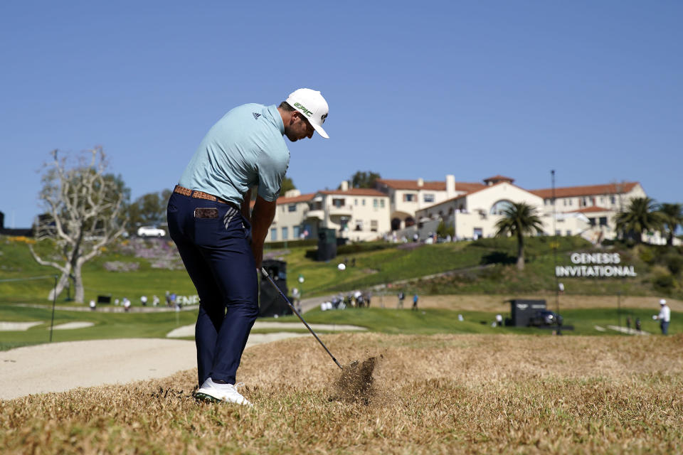 Sam Burns hits his second shot from the rough on the ninth hole during the second round of the Genesis Invitational golf tournament at Riviera Country Club, Friday, Feb. 19, 2021, in the Pacific Palisades area of Los Angeles. (AP Photo/Ryan Kang)