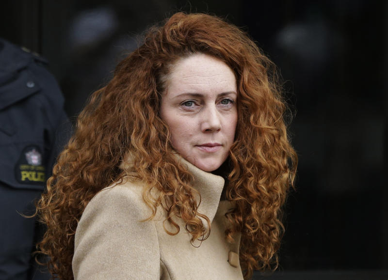 FILE This Wednesday, Sept. 26, 2012 file photo shows Rebekah Brooks, the former chief of News Corp.'s British operations, leaving the Old Bailey court in London London. Officials have charged the British prime minister's former media aide and the ex-chief of Rupert Murdoch's News International with bribery offenses. Britain's Crown Prosecution Service said Tuesday Nov. 20, 2012 that Andy Coulson and Rebekah Brooks were among four people being charged with conspiracy to commit misconduct in public office. (AP Photo/Lefteris Pitarakis, File)
