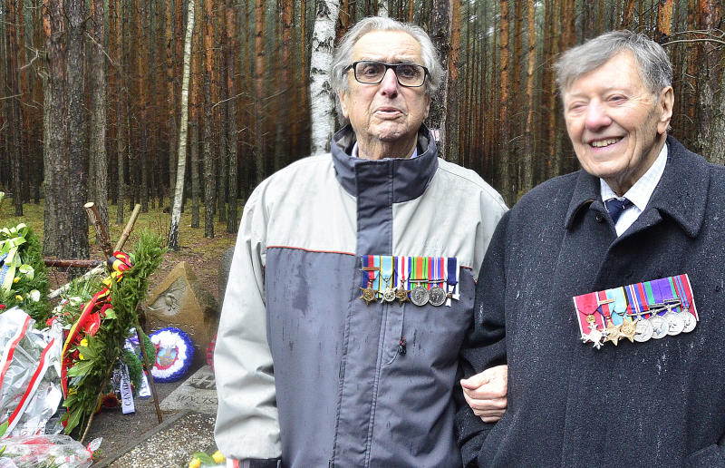 """In this picture taken Monday, March 24, 2014, former prisoners of war of the Nazi Stalag Luft III, Andrew Weisman, left, and Charles Clarke, right, are pictured during observances of the 70th anniversary of the Great Escape of Allied airmen from the camp near Zagan, Poland. Weisman and Clarke, both British, were prisoners at the camp after the escape that took place on the night of March 24, 1944, when a group of 76 prisoners emerged from a tunnel they had made in order to flee. Only three airmen made it home. Fifty others were executed when caught, and 23 were sent to other camps, but survived the war. The 1963 Hollywood movie """"The Great Escape,"""" starring Steve McQueen, tells the story. (AP Photo/Jan Mazur)"""