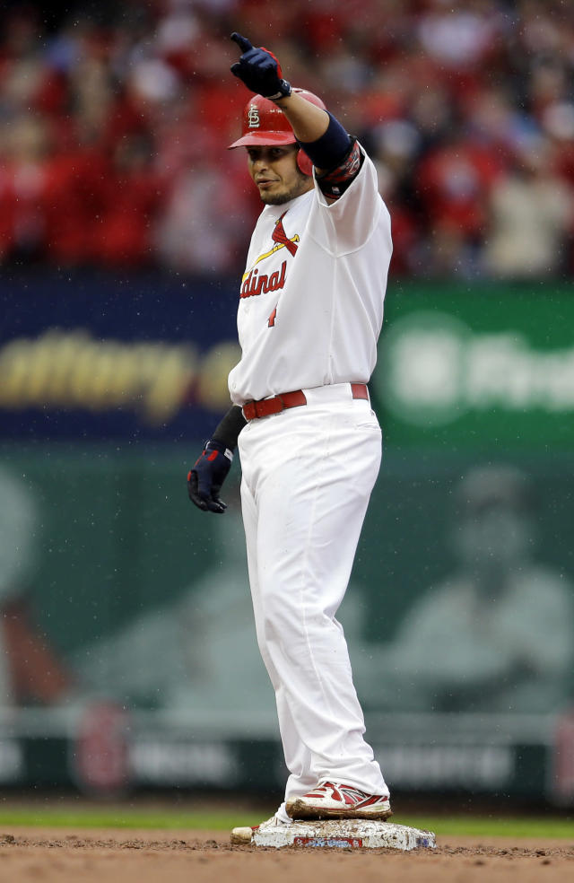 St. Louis Cardinals' Yadier Molina celebrates on second after hitting a three-run double during the first inning of a baseball game against the Cincinnati Reds, Monday, April 7, 2014, in St. Louis. (AP Photo/Jeff Roberson)
