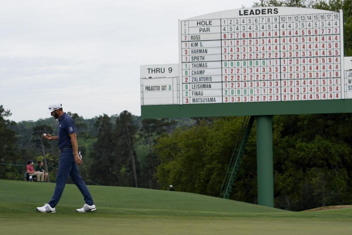Dustin Johnson walks off the 18th green after his second round in the Masters golf tournament on Friday, April 9, 2021, in Augusta, Ga. (AP Photo/David J. Phillip)