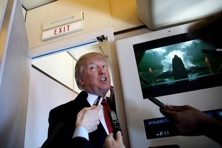 FIL PHOTO: U.S. President Donald Trump talks to journalists, members of the travel pool, on board Air Force One during his trip to Palm Beach, Florida, U.S., April 6, 2017. REUTERS/Carlos Barria/Files