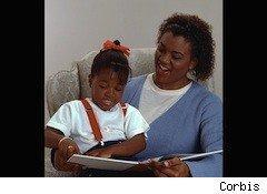 a mom reads a book to her daughter