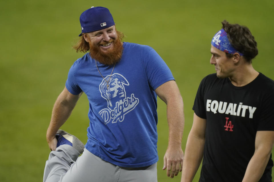 Los Angeles Dodgers third baseman Justin Turner, left, and second baseman Enrique Hernandez warm up during batting practice before Game 5 of the baseball World Series against the Tampa Bay Rays Sunday, Oct. 25, 2020, in Arlington, Texas. (AP Photo/Eric Gay)