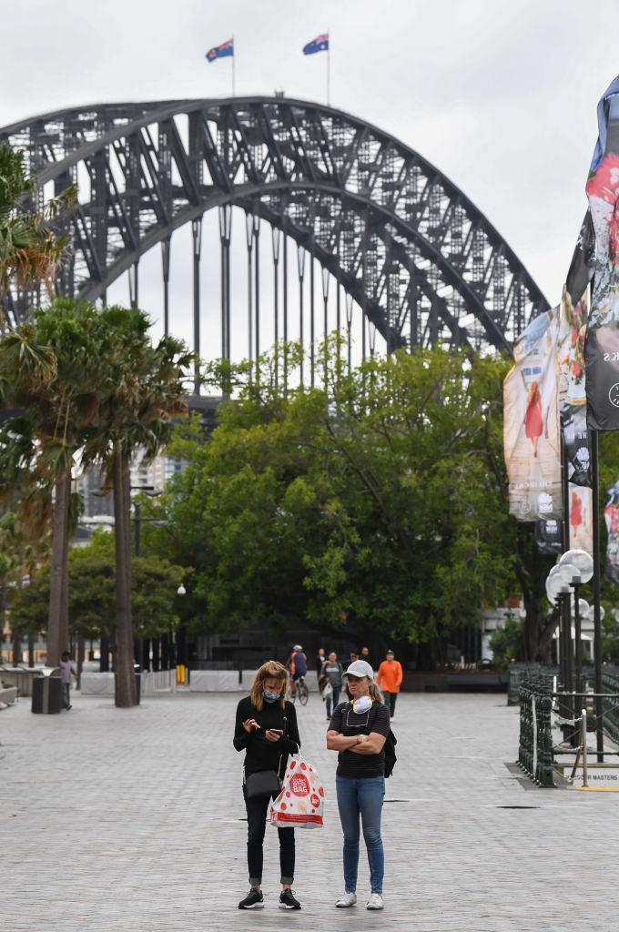 Two tourists in a deserted Circular Quay area. Source: Getty