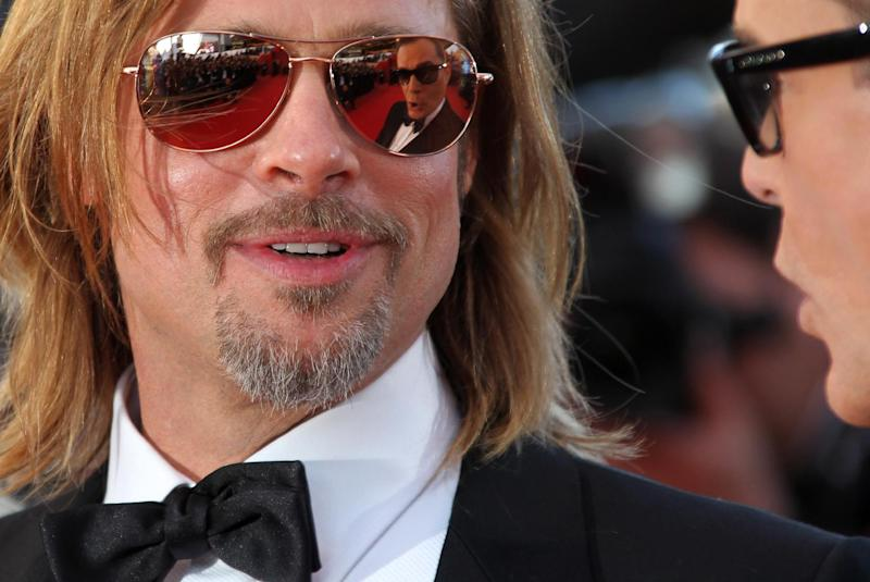 Actor Brad Pitt arrives for the screening of Killing Them Softly at the 65th international film festival, in Cannes, southern France, Tuesday, May 22, 2012. (AP Photo/Joel Ryan)