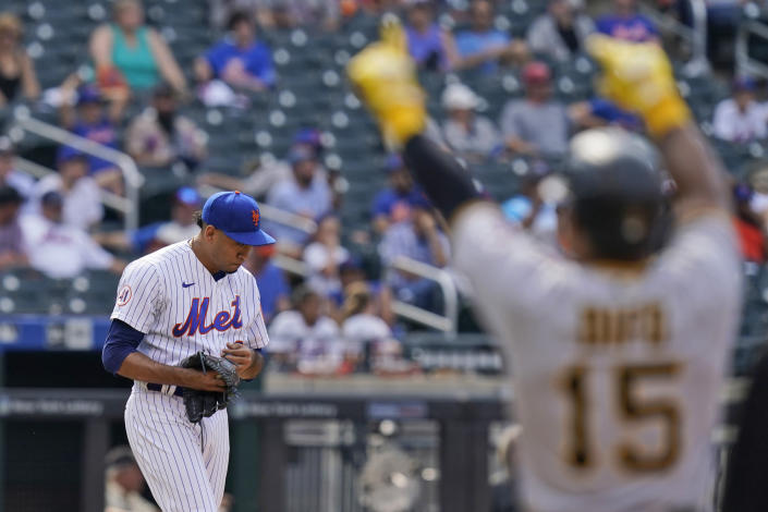 New York Mets relief pitcher Edwin Diaz, left, reacts after giving up a go-ahead RBI-single to Pittsburgh Pirates' Wilmer Difo, right, during the ninth inning of a baseball game at Citi Field, Sunday, July 11, 2021, in New York. (AP Photo/Seth Wenig)