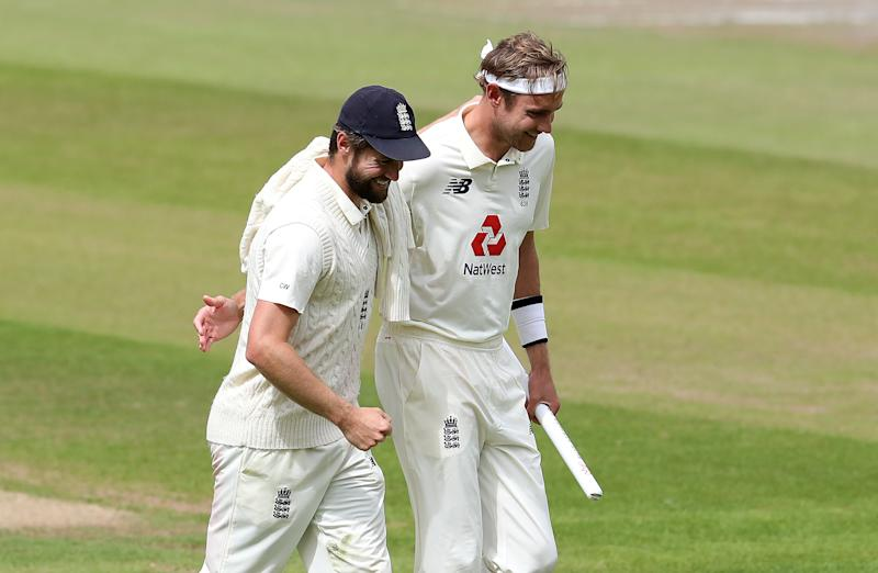 England's Chris Woakes (left) and Stuart Broad smile and embrace at the end of day five.