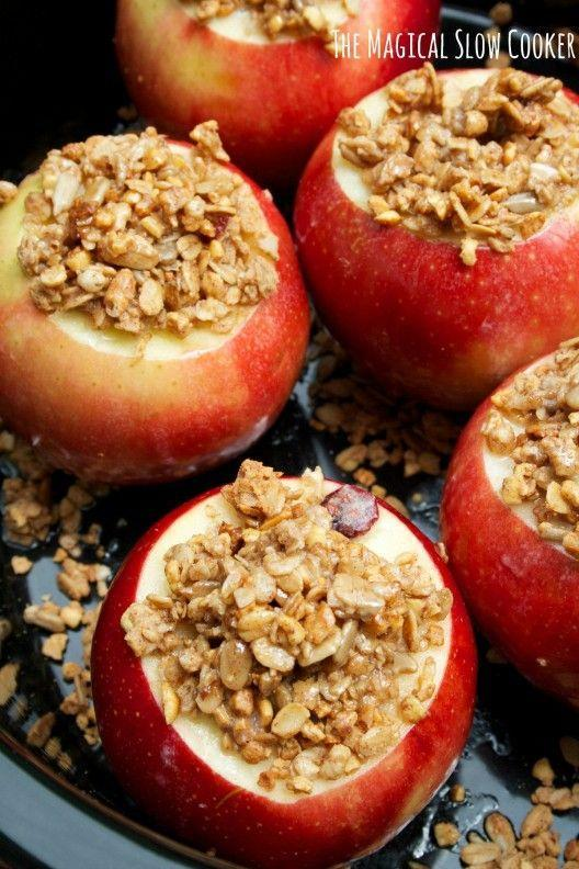 """<p>Now you can satisfy your sweet tooth with these delicious granola-stuffed apples. Don't forget a scoop of ice cream!</p><p><strong>Get the recipe at <a href=""""http://www.themagicalslowcooker.com/2014/05/27/slow-cooker-baked-apples/"""" rel=""""nofollow noopener"""" target=""""_blank"""" data-ylk=""""slk:The Magical Slow Cooker"""" class=""""link rapid-noclick-resp"""">The Magical Slow Cooker</a>.</strong> </p>"""