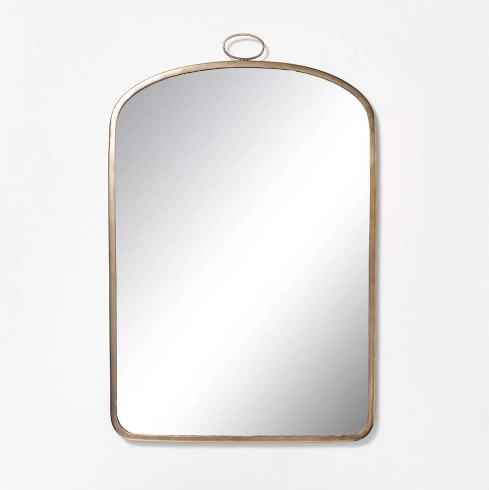 <p>Whether you want to give yourself a once-over before leaving the house or admire your postsummer glow, this <span>Hearth &amp; Hand With Magnolia Arched Brass Mirror</span> ($55) will work overtime in your space. The brass frame is fall-friendly but versatile enough to leave out year-round. </p>