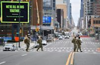 Members of the Army National Guard cross the street by the Jacob K. Javits Convention Center on March 31, 2020 in New York City