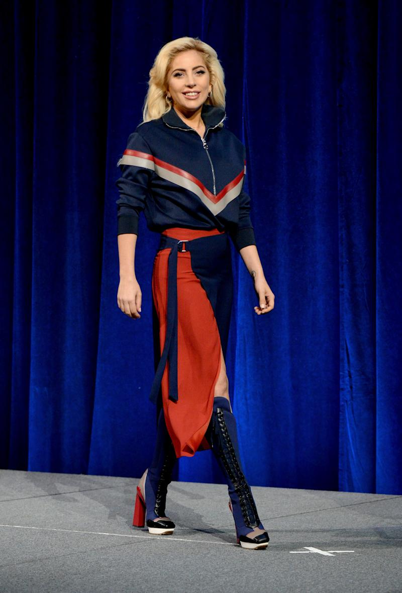 Gaga sported a chic athletic-inspired look from Versace for a press conference before her Superbowl Halftime show performance.