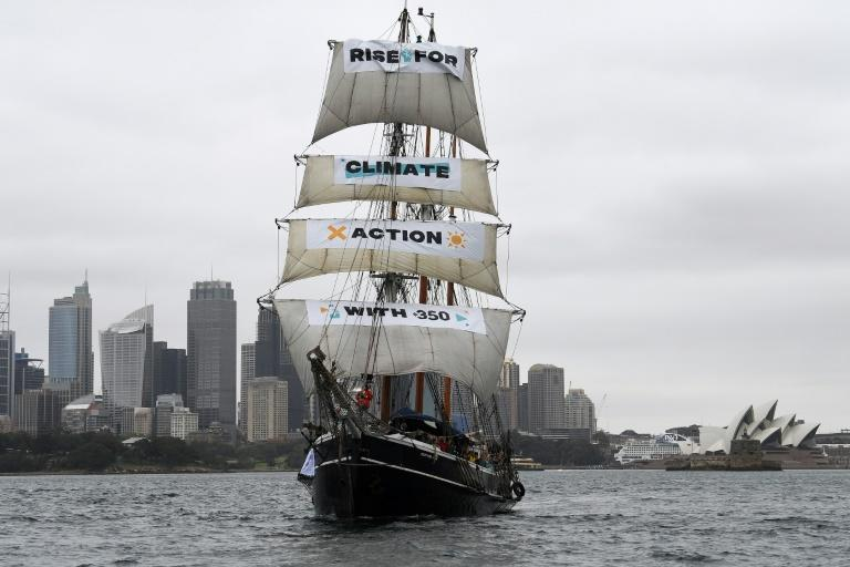 The tall ship Southern Swan sails on Sydney Harbour as part of an environmental protest