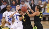 Oregon's Te-Hina Paopao (12) reaches for a loose ball with teammate Sydney Parrish (33) against UCLA during the second half on an NCAA college basketball game, Friday, Feb. 19, 2021 in Los Angeles. (Keith Birmingham/The Orange County Register via AP)