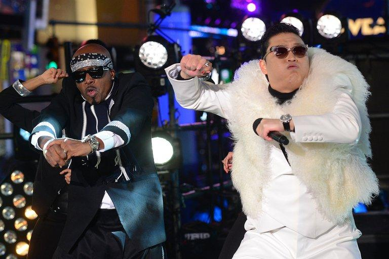 """South Korean singer Psy (right) performs with US singer MC Hammer during New Year's Eve celebrations in Times Square in New York on December 31, 2012. China's hugely popular Lunar New Year television galas aim to woo even more viewers this year with foreign megastars including Celine Dion and """"Gangnam Style"""" pop sensation Psy, state media said Thursday"""