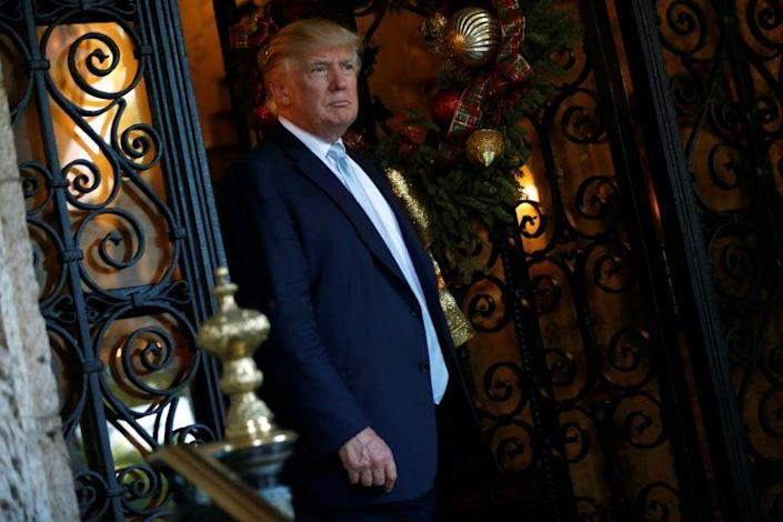 Donald Trump speaks briefly to reporters between meetings at the Mar-a-lago Club in Palm Beach, Fla. (Photo: Reuters/Jonathan Ernst)