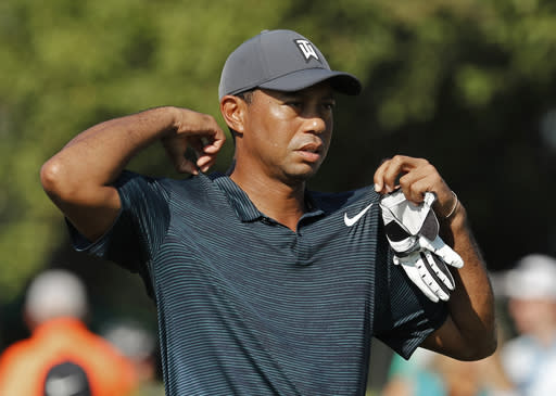 "<a class=""link rapid-noclick-resp"" href=""/pga/players/147/"" data-ylk=""slk:Tiger Woods"">Tiger Woods</a> had three birdies in seven holes on Friday before rain stopped the second round of the PGA Championship. (AP)"