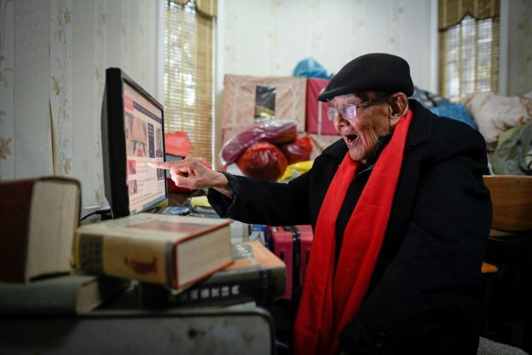 Gu Bin, a former accountant, mostly stays home after a fall a few years ago -- but he maintains his sharp wit and keeps connected with the outside world through the internet