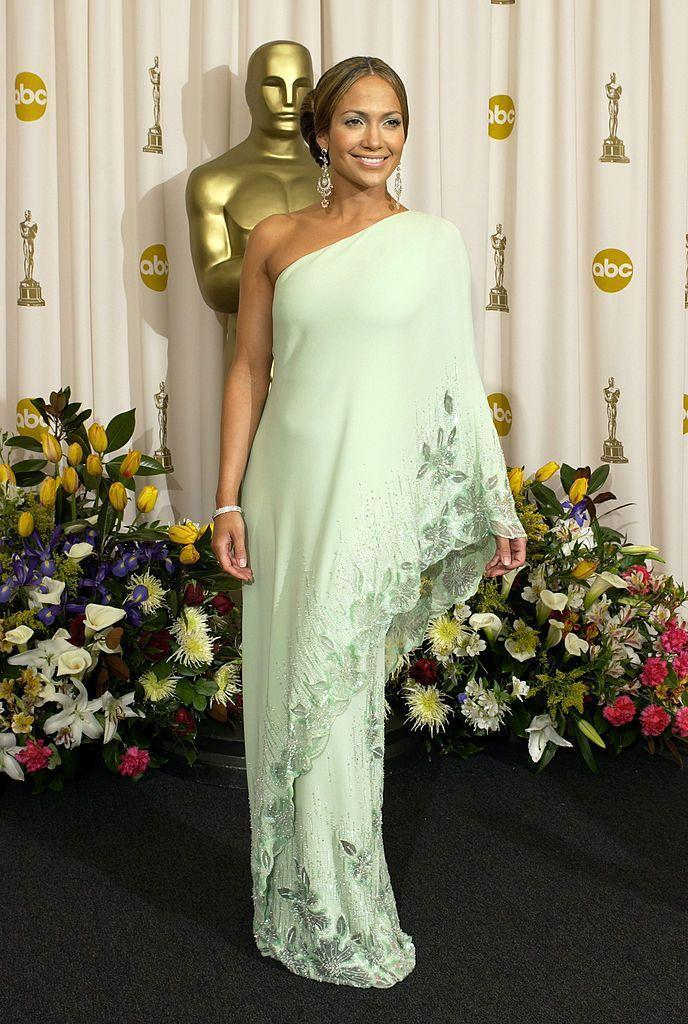 <p>The singer and actor wore a vintage sea foam green Valentino dress to the Oscars. </p>