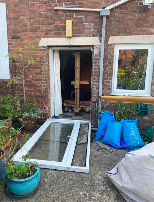 Steve Goodchild removed his patio door to get the boat through. (SWNS)
