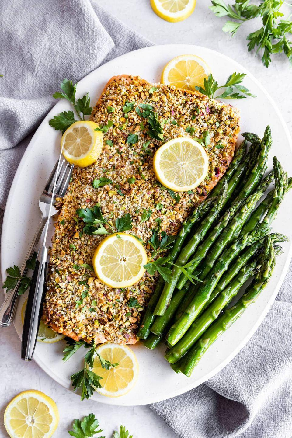"""<p>Top salmon with a crunchy mixture of panko, pistachios, and parmesan before baking to take it to the next level. This restaurant-worthy meal looks super impressive but it takes just 20 minutes to make. </p><p><strong>Get the recipe at <a href=""""https://www.twopeasandtheirpod.com/pistachio-crusted-baked-salmon/"""" rel=""""nofollow noopener"""" target=""""_blank"""" data-ylk=""""slk:Two Peas and Their Pod"""" class=""""link rapid-noclick-resp"""">Two Peas and Their Pod</a>.</strong> </p>"""