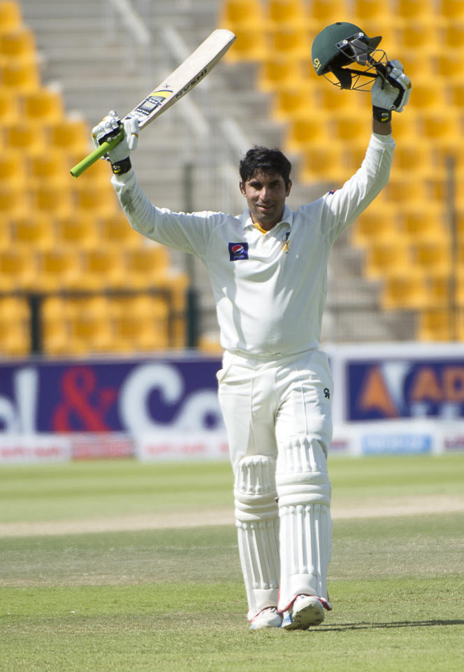 Pakistan captain Misbah-ul Haq celebrates his century on the the third day of their first Test against South Africa at the Sheikh Zayed Cricket Stadium in Abu Dhabi on October 16, 2013. Pakistan's pace-cum-spin attack caught world number one Test team South Africa napping on the third day of the first Test in Abu Dhabi.  AFP PHOTO/STR        (Photo credit should read -/AFP/Getty Images)