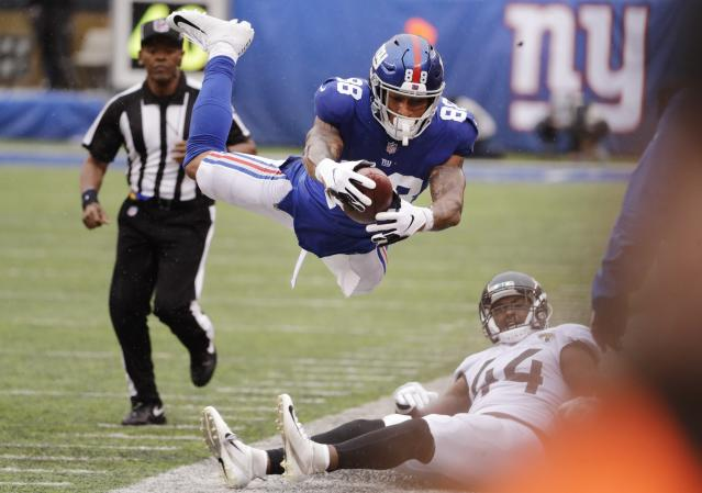 <p>New York Giants tight end Evan Engram (88) leaps over Myles Jack (44) during the second half of an NFL football game Sunday, Sept. 9, 2018, in East Rutherford, N.J. (AP Photo/Seth Wenig) </p>