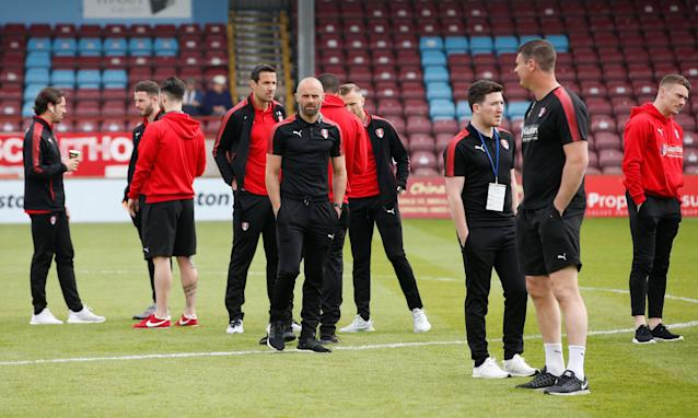 "Soccer Football - League One Play Off Semi Final First Leg - Scunthorpe United v Rotherham United - Glanford Park, Scunthorpe, Britain - May 12, 2018 Rotherham United manager Paul Warne (C) has a walk around the pitch with the players after arriving at the stadium Action Images/Craig Brough EDITORIAL USE ONLY. No use with unauthorized audio, video, data, fixture lists, club/league logos or ""live"" services. Online in-match use limited to 75 images, no video emulation. No use in betting, games or single club/league/player publications. Please contact your account representative for further details."