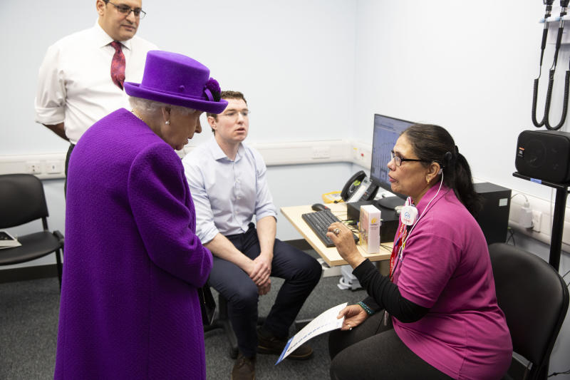 Queen Elizabeth II meeting Volunteer Vinnari Shah during the official opening of the new premises of the Royal National ENT and Eastman Dental Hospitals in London.
