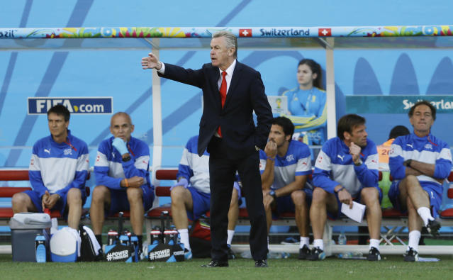 Switzerland's coach Ottmar Hitzfeld instructs his players from the sideline during the World Cup round of 16 soccer match between Argentina and Switzerland at the Itaquerao Stadium in Sao Paulo, Brazil, Tuesday, July 1, 2014. (AP Photo/Kirsty Wigglesworth)