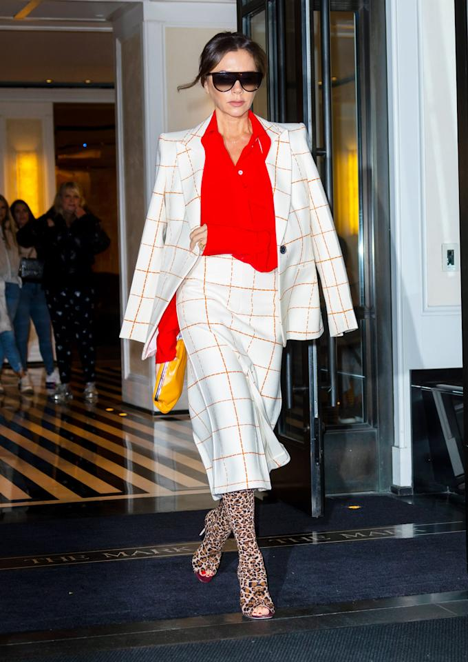 """<p>No one does high fashion street style quite like <a class=""""sugar-inline-link ga-track"""" title=""""Latest photos and news for Victoria Beckham"""" href=""""https://www.popsugar.com/Victoria-Beckham"""" target=""""_blank"""" data-ga-category=""""Related"""" data-ga-label=""""https://www.popsugar.com/Victoria-Beckham"""" data-ga-action=""""&lt;-related-&gt; Links"""">Victoria Beckham</a>, so this look is definitely for the more courageous. Mixing a checkered print with leopard print open-toed boots probably doesn't <em>sound</em> like it's going to work, but when you look at this pic, you can't tell me that it isn't absolute fire. See if you can match your statement over-the-knee boots with some fun patterns in your closet for a daring fashion moment.</p>"""