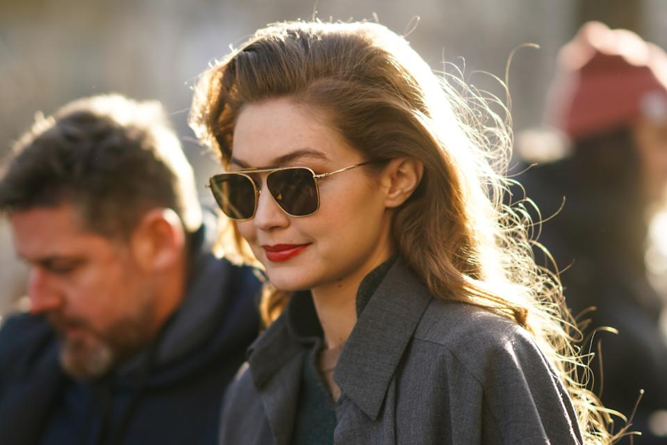 PARIS, FRANCE - FEBRUARY 26: Gigi Hadid wears sunglasses, a gray jacket, a green wool pullover, outside Lanvin, during Paris Fashion Week - Womenswear Fall/Winter 2020/2021, on February 26, 2020 in Paris, France. (Photo by Edward Berthelot/Getty Images)
