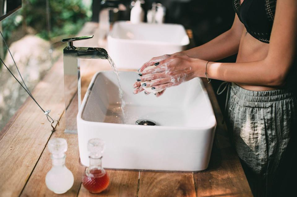 "<p>In 2020, we all got a lesson in intense hand washing. Counting to 20 while scrubbing away, constantly using hand sanitizer, and being more conscious of what we touch—you name it. And since we're still navigating living life with COVID-19 in 2021, we've got to keep up the cleanliness. Now that we have our germ-killing routines down to a science, we can think about making them a little more *luxe.* Sure, that might mean a <a href=""https://www.marieclaire.com/beauty/g25780669/beauty-products-that-will-change-your-life/"" rel=""nofollow noopener"" target=""_blank"" data-ylk=""slk:hydrating lotion"" class=""link rapid-noclick-resp"">hydrating lotion</a> that smells like roses or a lemon-scented sanitizer, but we find that the easiest way to <a href=""https://www.marieclaire.com/beauty/a34210010/relaxing-bed-and-bath-products/"" rel=""nofollow noopener"" target=""_blank"" data-ylk=""slk:upgrade"" class=""link rapid-noclick-resp"">upgrade</a> your cleansing situation is to invest in a new hand soap to use every day and make your sink look pretty. </p><p>We all have different skin types, and not just on our faces. Even our hands deserve a more personalized touch, and selecting a formula that works for you can make all the difference—especially since we're cleansing our palms ten times as much lately. Eczema Honey's wash works wonders for angry skin, Aesop's culty wash buffs away rough patches while you cleanse, and MyKirei's foamy formula softens the most sensitive skin. Or even if you just want something to chic up your shelfie and have guests wondering where you shop, there are glass bottles and pretty containers to add a little spice to a neutral bathroom. Here, the best hand soaps, rinses, and scrubs on the market to start off your year right—and thoroughly cleansed. </p>"