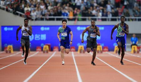 Athletics - Diamond League - Shanghai - Shanghai Stadium, Shanghai, China - May 18, 2019 Noah Lyles of the U.S. on his way to winning the Men's 100m REUTERS/Aly Song