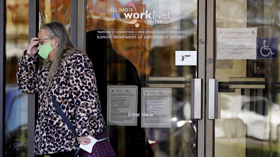 Mandatory Credit: Photo by Nam Y Huh/AP/Shutterstock (11002151b)Woman reacts as she leaves after she checked information signs at IDES (Illinois Department of Employment Security) WorkNet center in Arlington Heights, Ill.