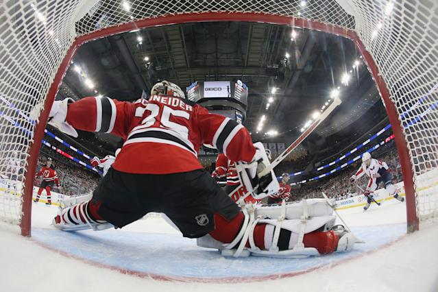 NEWARK, NJ - APRIL 04: Cory Schneider #35 of the New Jersey Devils gets in position to stop Marcus Johansson #90 of the Washington Capitals during the second period at the Prudential Center on April 4, 2014 in Newark, New Jersey. (Photo by Bruce Bennett/Getty Images)