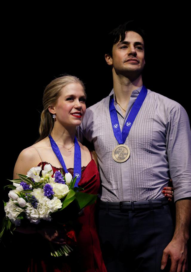 Figure Skating - World Figure Skating Championships - The Mediolanum Forum, Milan, Italy - March 24, 2018 Canada's Kaitlyn Weaver and Andrew Poje pose as they celebrate third place after the Ice Dance Free Dance REUTERS/Alessandro Garofalo
