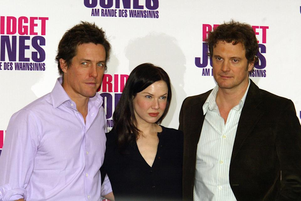 """Hugh Grant, Renee Zellweger and Colin Firth during """"Bridget Jones : The Edge of Reason"""" Berlin Photocall at Hotel Adlon in Berlin, Germany. (Photo by Kurt Vinion/WireImage)"""