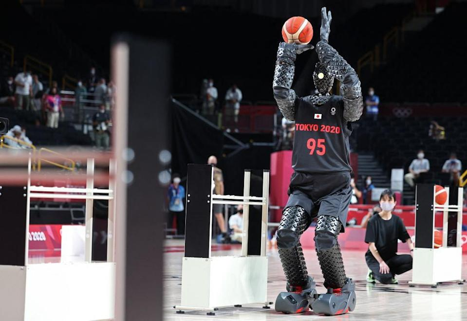 Toyota has created a 6ft10in basketball-shooting robot named CUE that uses sensors on its torso to judge the distance and angle of the basket.