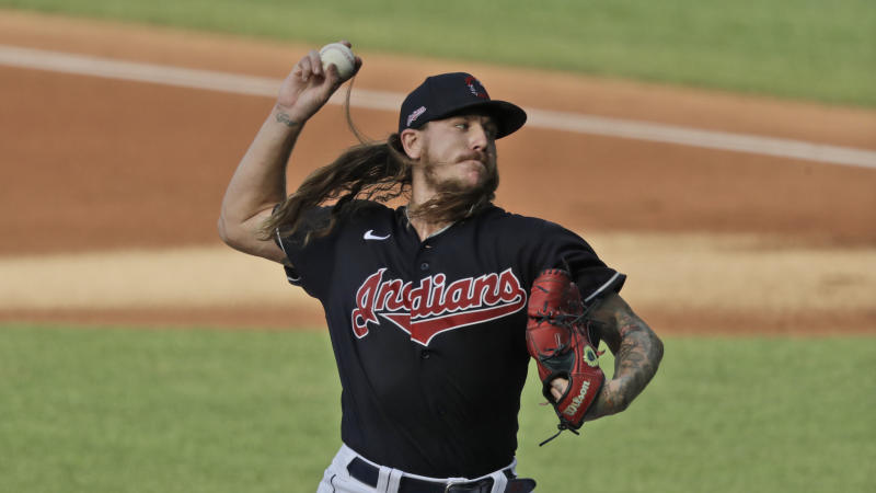 Cleveland Indians starting pitcher Mike Clevinger delivers a pitch in the first inning.