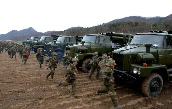 <p>North Korean soldiers run as they attend military training in an undisclosed location in this picture released by the North's official KCNA news agency in Pyongyang March 11, 2013. (KCNA/Reuters) </p>