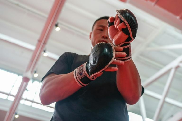 Former train welder back on track for UFC as China base reopens