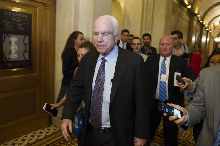 Sen. John McCain, R-Az., is pursued by reporters after casting a 'no' vote on a a measure to repeal parts of former President Barack Obama's health care law, on Capitol Hill in Washington, Friday, July 28, 2017. (Photo: Cliff Owen/AP)